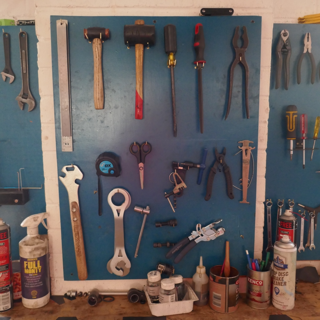 Tool board with a variety of bike tools.